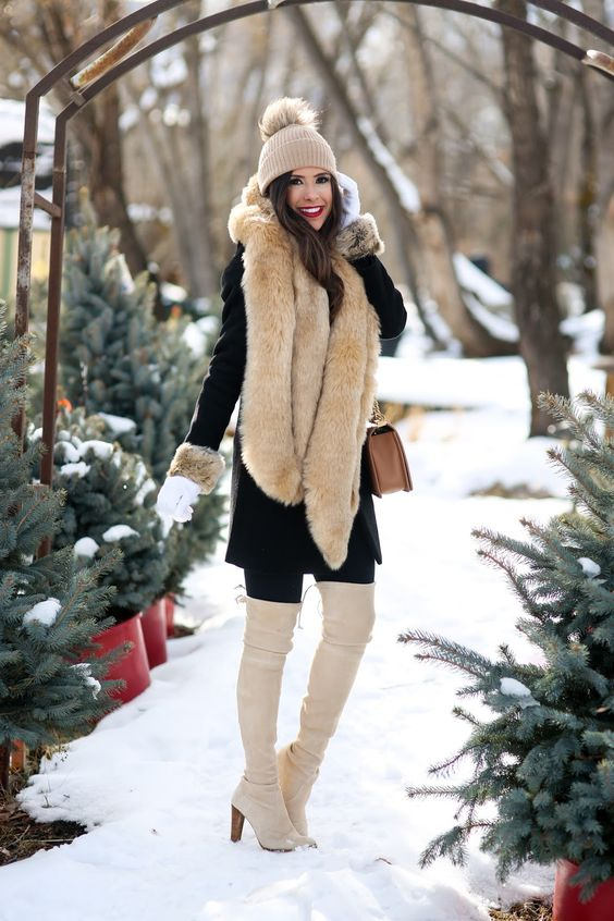 ivory over the knee boots, a black coat with faux fur and a cozy beanie