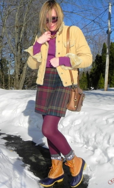 With purple turtleneck, plaid mini skirt, yellow jacket and purple tights