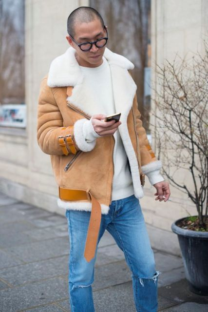 With white sweater and distressed jeans