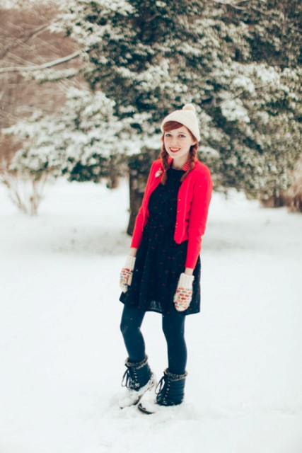 With black dress, red blazer and beanie