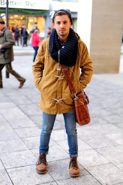 With unique parka, knitted scarf and jeans
