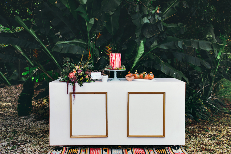 cake table - photo by Ivy Road Photography http://ruffledblog.com/palm-springs-inspired-wedding-editorial-from-australia