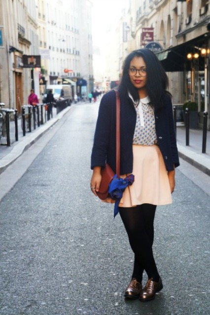 With pastel color skirt, jacket, brown bag and black tights