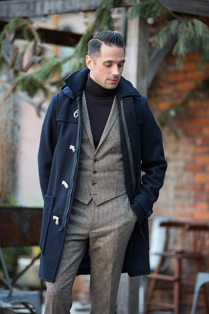 With checked suit and dark color turtleneck