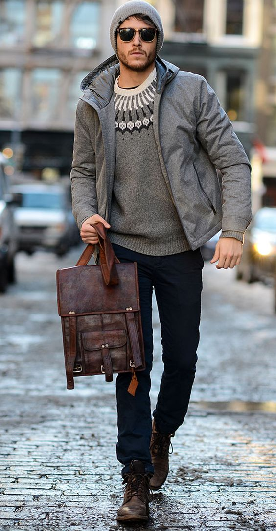 navy pants, a patterned sweater, a grey puff coat