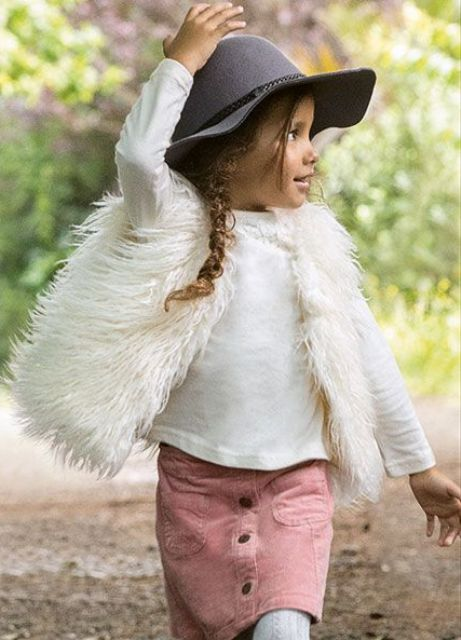 a rose quartz button down skirt, a white jersey and a faux fur vest