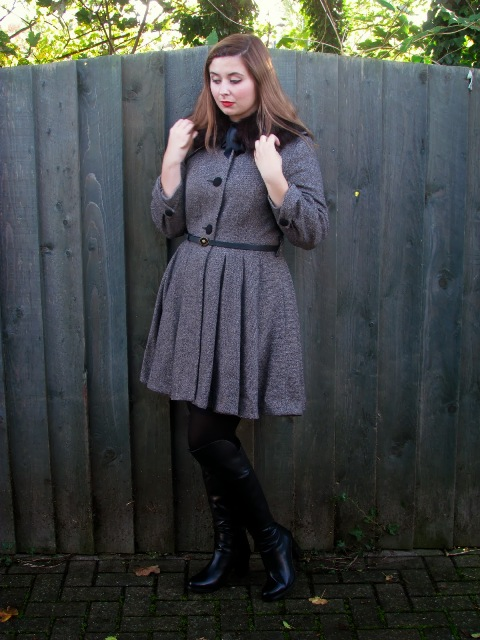 With dress, black tights and high boots