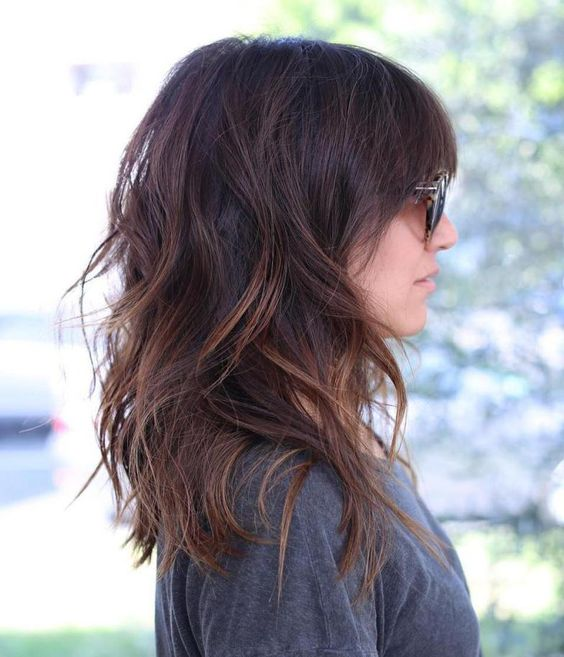 medium length layered hair with caramel highlights