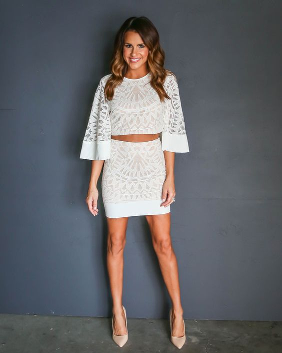 two-piece dress with a mini skirt and trumpet sleeves