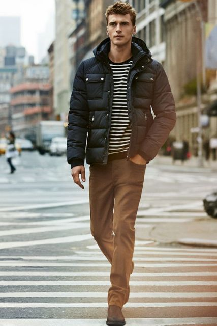 With striped shirt, brown pants and shoes