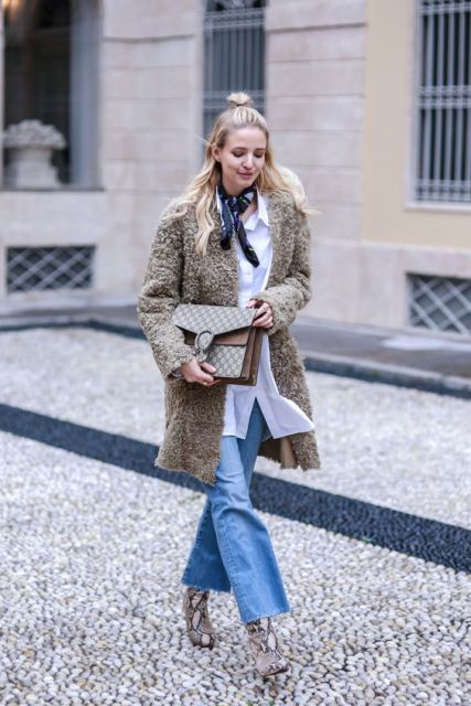 With white long shirt, wide leg jeans, printed boots and scarf