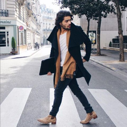 With white shirt, black coat, brown scarf and jeans