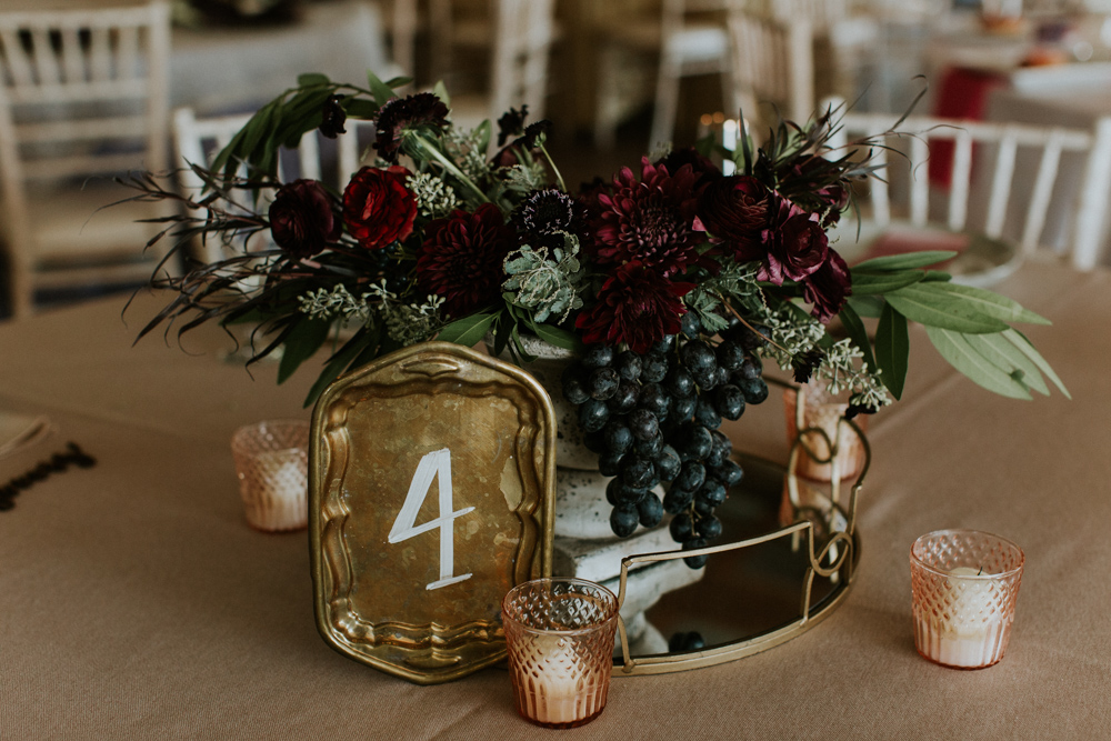 moody-colored wedding centerpieces - photo by Caitlin Rose Photography http://ruffledblog.com/fall-wedding-inspiration-from-the-big-fake-wedding