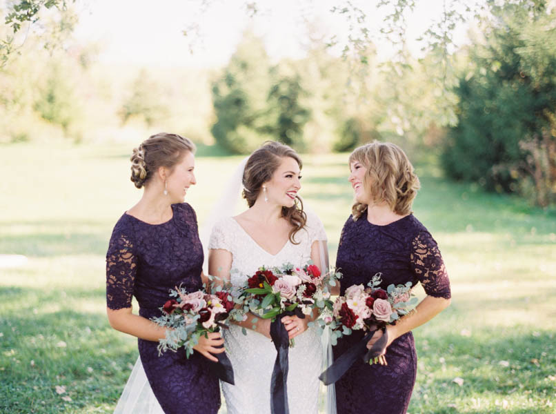 lacy bridesmaids dresses - photo by Kelli Lynn Photography http://ruffledblog.com/fall-wedding-inspiration-from-the-big-fake-wedding