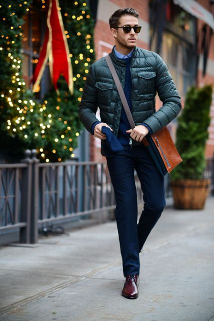 With navy blue sweater, trousers and brown shoes