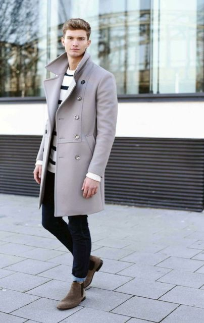With striped shirt, cuffed jeans and pastel color coat