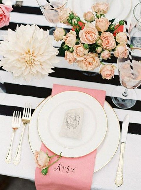 black and blush wedding table decor with pink and white touches
