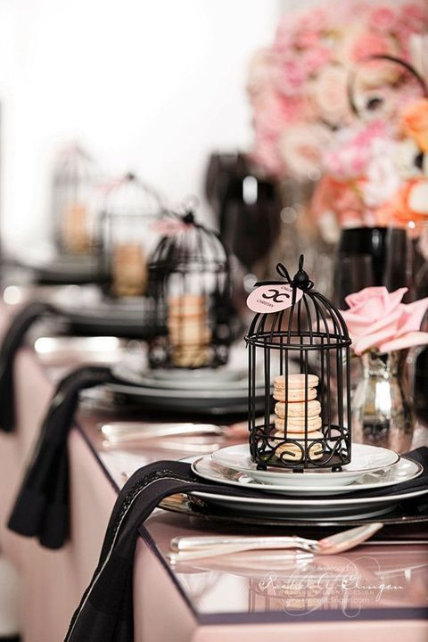 black and pink tablescape, black cages with blush macarons for favors