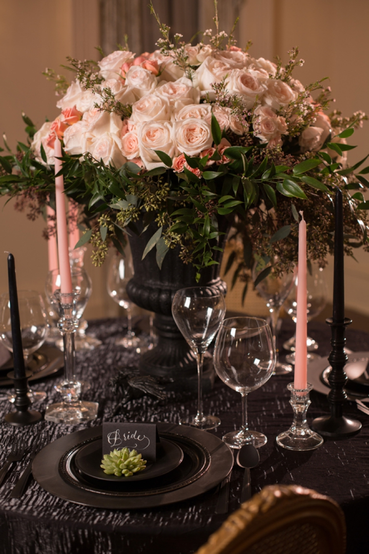 dramatic black table decor with blush blooms and candles