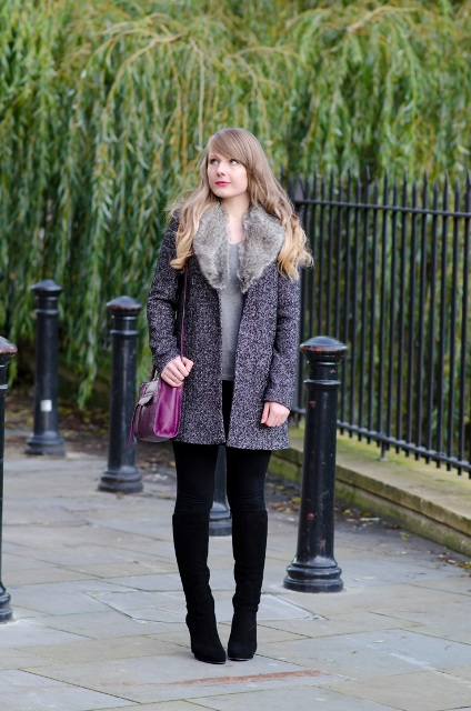 With gray shirt, black skinnies, suede boots and purple bag