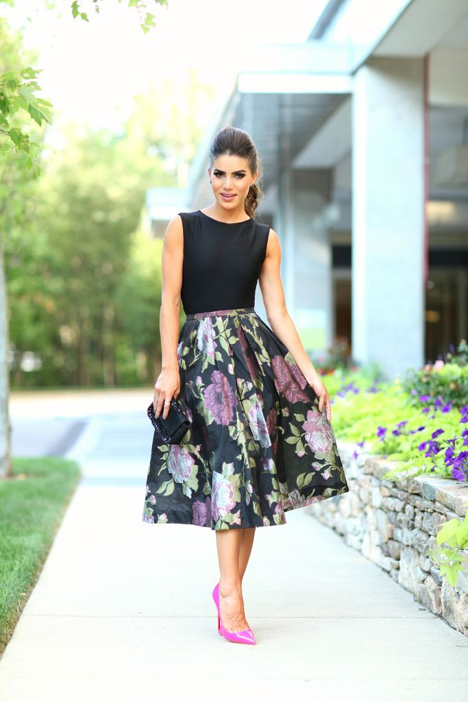 a floral midi, a black top and fuchsia shoes