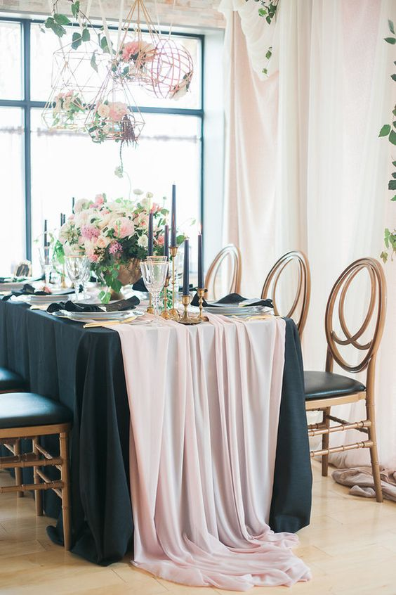 blush and black table setting with black candles and ivory and pink flowers