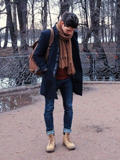 With cuffed jeans, knitted scarf and navy blue coat