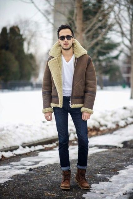 With white t-shirt, cuffed jeans and brown boots