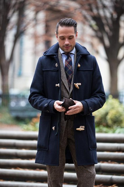 a navy duffle coat, a grey tweed suit and a striped tie