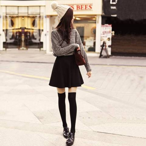With sweater, mini skirt and beanie