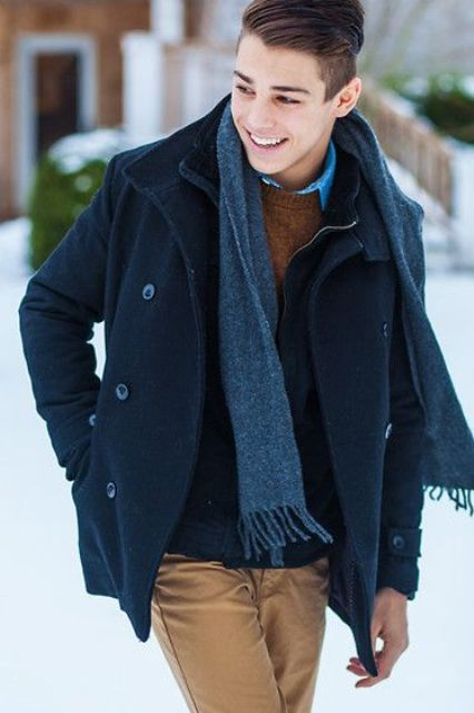 ocher pants, a sweater over the shirt and a navy coat