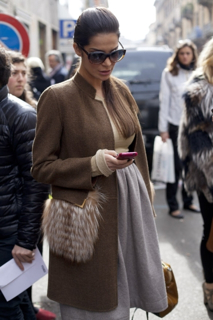 With neutral shirt and gray A-line skirt
