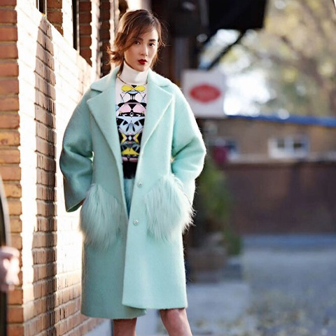 With printed turtleneck and mint skirt