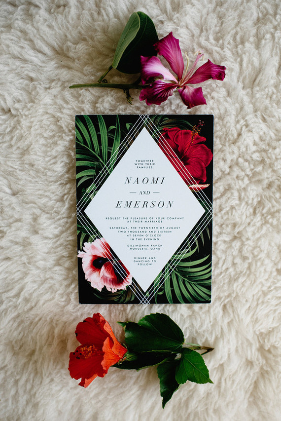 The stationery was done in black with tropical flowers and leaves