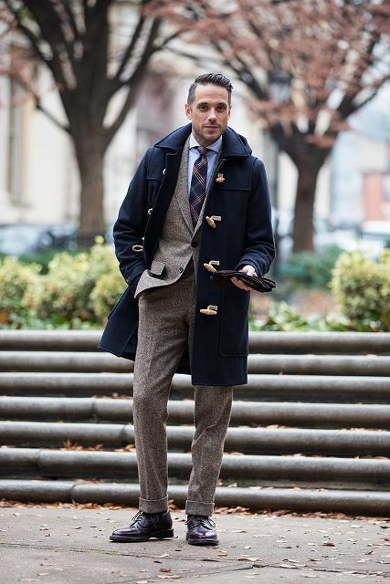 With tweed suit, blue shirt and printed tie