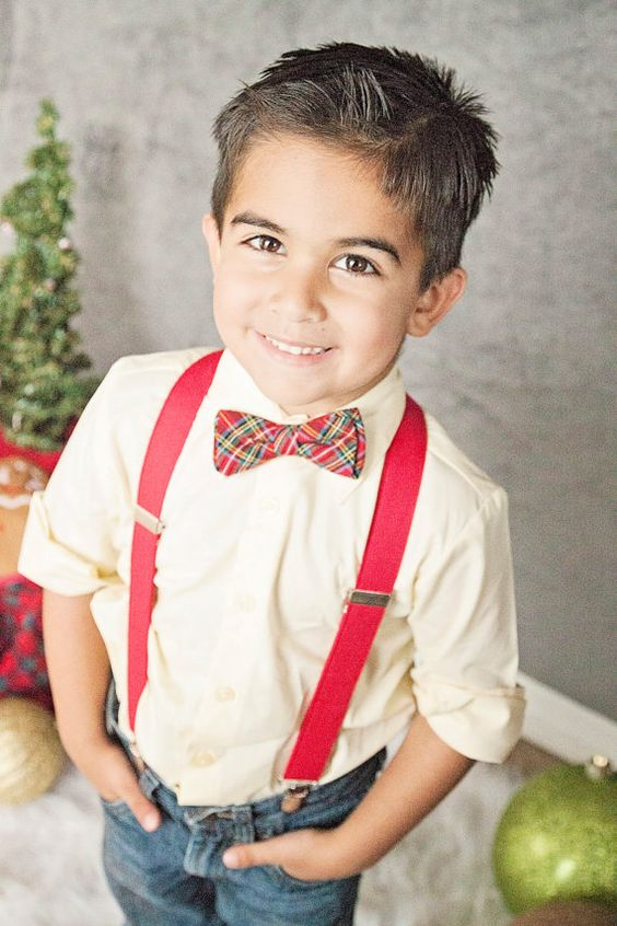 jeans, an ivory shirt, red suspenders and a plaid bow tie