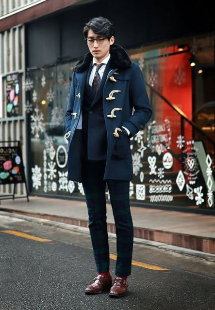 With navy blue blazer, plaid trousers and brown shoes