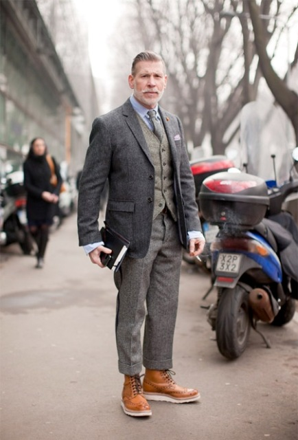 With tweed jacket, light gray vest and trousers