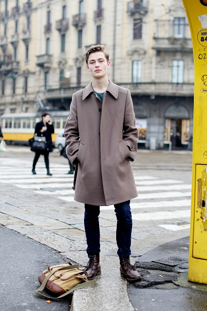 With neutral color coat and jeans