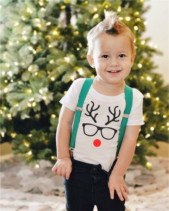 jeans, suspenders and a white tee with a reindeer