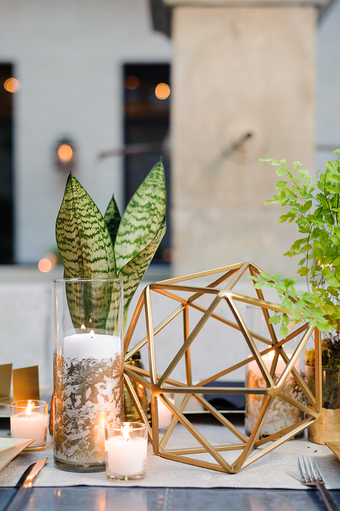 These cute gold geometric decorations and succulents were ideal for this modern wedding