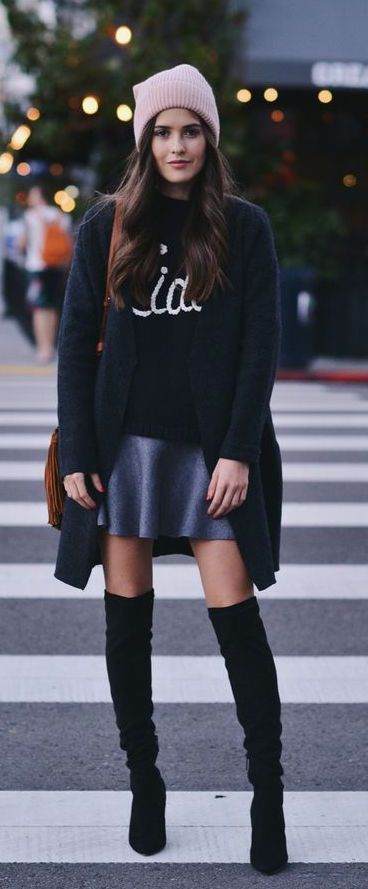 24 suede knee boots, a mini skirt, a sweater and a long black cardigan
