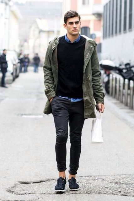 With denim shirt, black sweater and cuffed pants