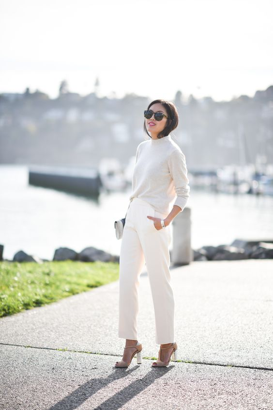 pants, a white sweater and nude heels if it