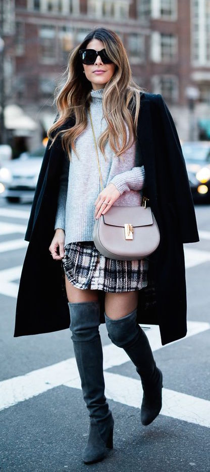 over the knee boots, a plaid skirt, a grey sweater and a black coat