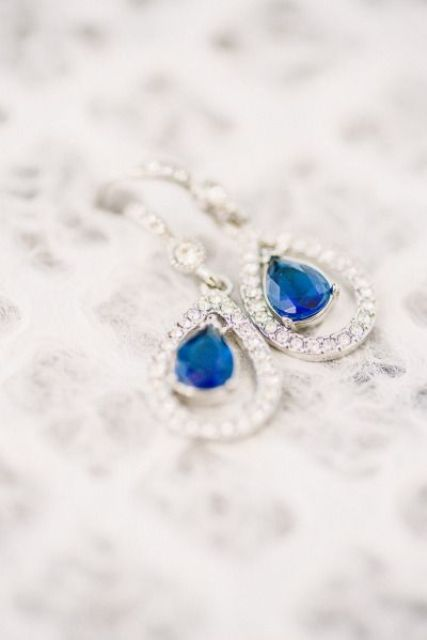 stylish earrings with blue stones inside