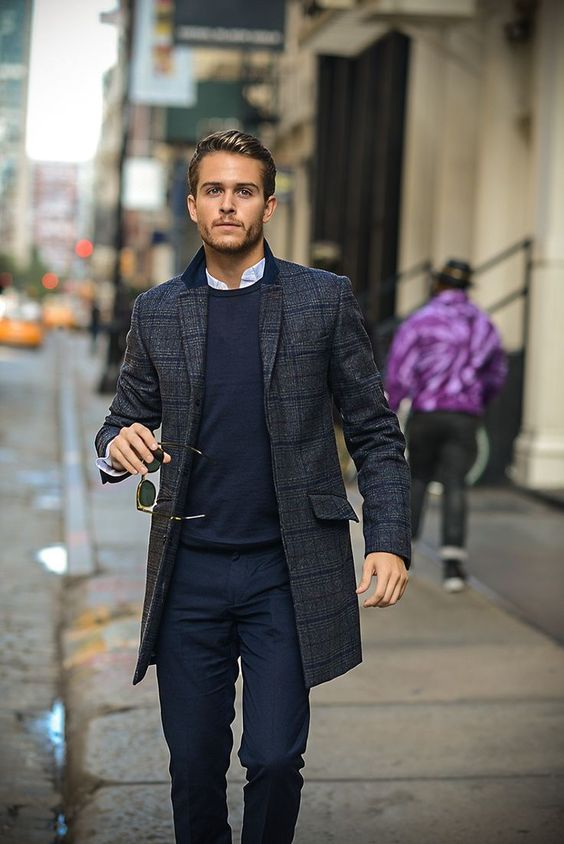 navy pants and a sweater, a plaid tweed coat