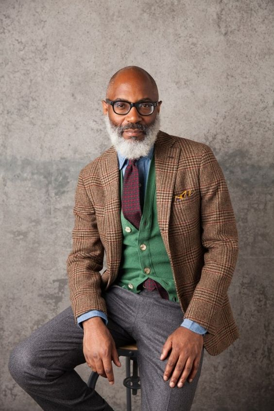 a bold look for a creative job - a tweed jacket, a green vest and grey pants