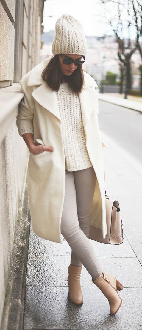 neutrals - grey jeans, a white chunky sweater, beanie and coat, tan heels