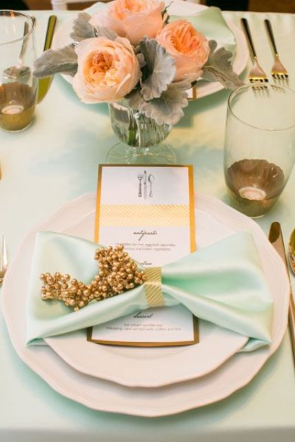 a beautiful mint tablescape with peach flowers and gold touches
